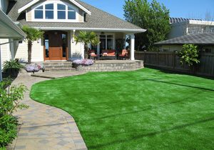 artificial grass in front lawn of home