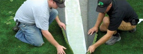 professionals installing and seaming artificial grass together