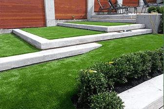 artificial grass staircase in residential backyard
