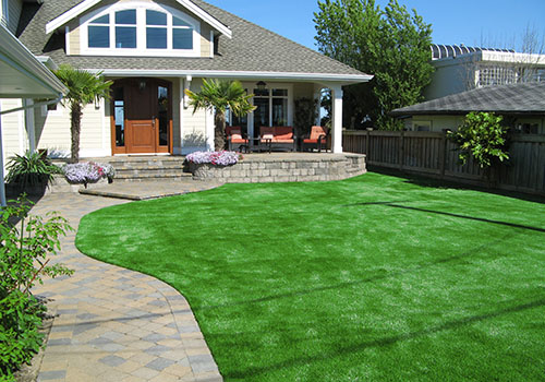 artificial grass lawn in residential front yard