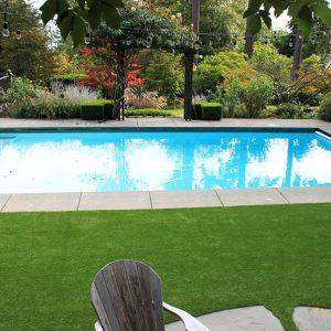 artificial grass installed in backyard beside pool