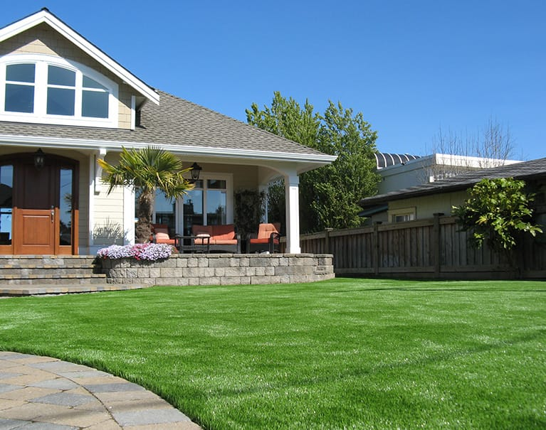 artificial grass in front lawn of residential home