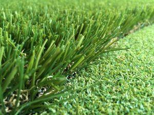close up photo of artificial grass edge against artificial putting green grass