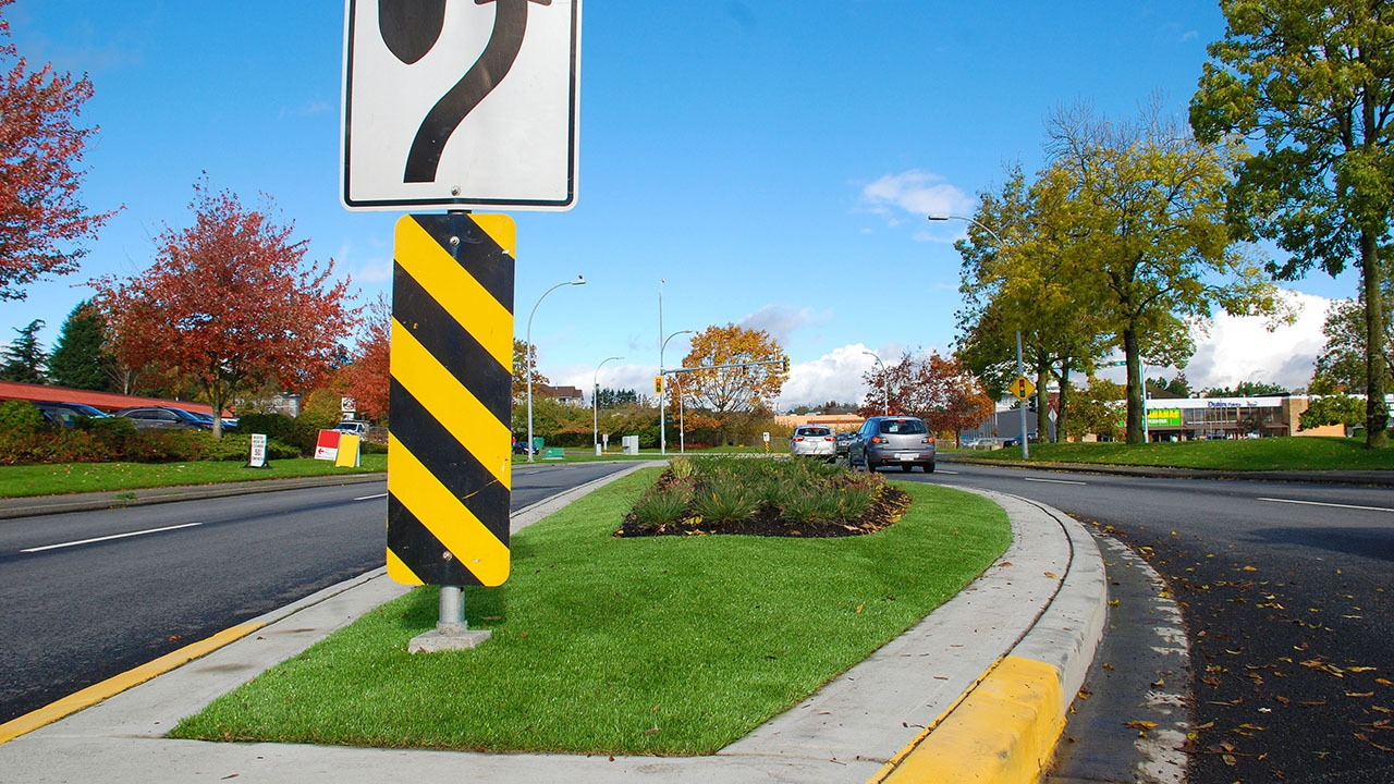 Artificial grass with road sign