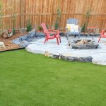 Artificial grass with fire and table sitting