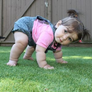 Girl playing on the artificial grass