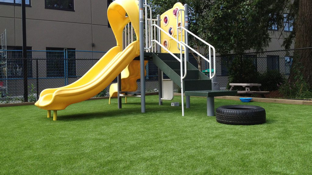 playground at school yard featuring artificial grass lawn
