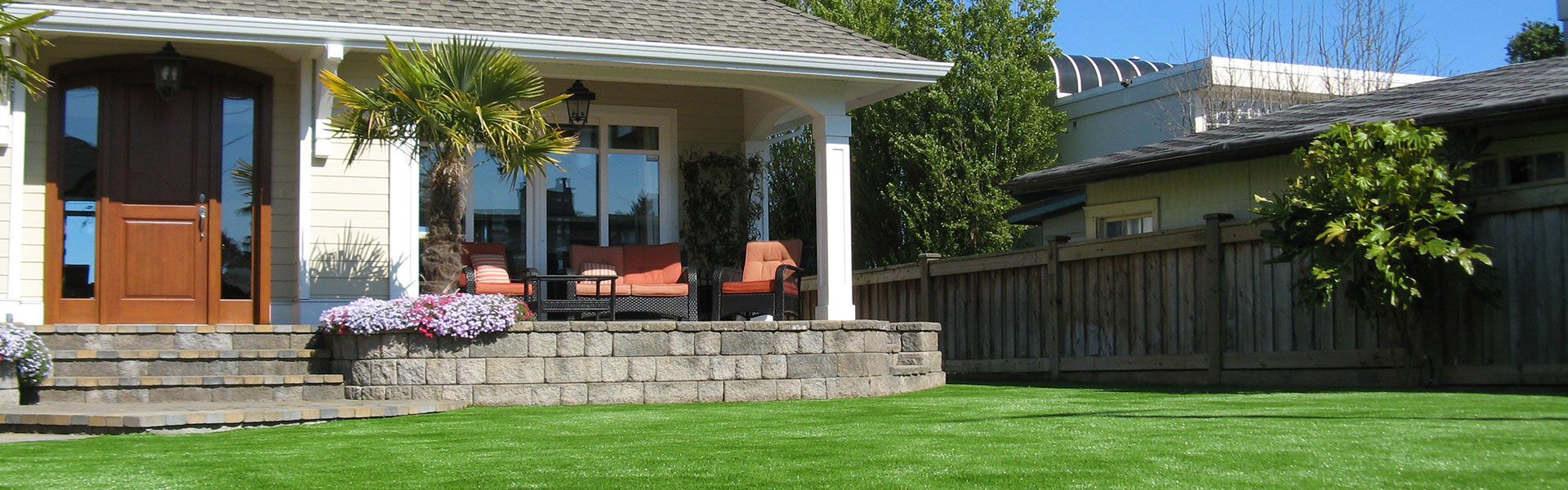 artificial turf installed in front yard of house porch